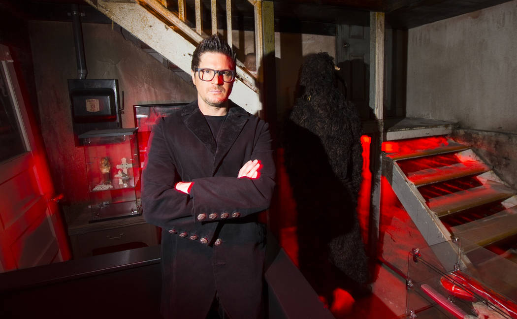 "Zak Bagans, paranormal investigator and host of Travel Channel's ""Ghost Adventures,"" poses for a photo in a room with items from his upcoming documentary ""Demon House"" at the H ..."
