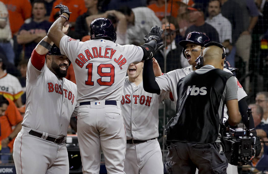 Boston Red Sox's Jackie Bradley Jr. celebrates after his grand slam against the Houston Astros during the eighth inning in Game 3 of a baseball American League Championship Series on Tuesday, Oct. ...