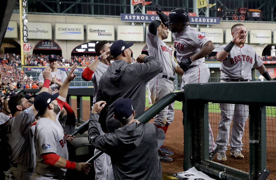 Boston Red Sox's Jackie Bradley Jr. celebrates in the dugout after his grand slam against the Houston Astros during the eighth inning in Game 3 of a baseball American League Championship Series on ...