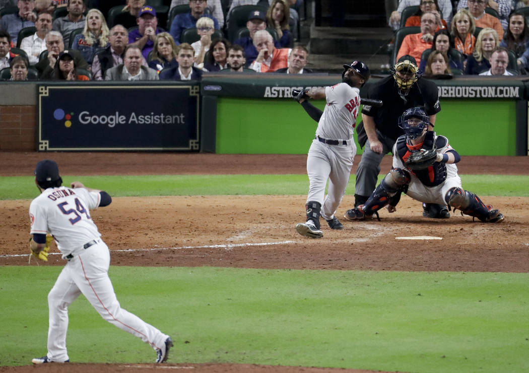 Boston Red Sox's Jackie Bradley Jr., right, watches his grand slam off Houston Astros relief pitcher Roberto Osuna during the eighth inning in Game 3 of a baseball American League Championship Ser ...
