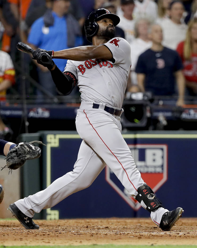 Boston Red Sox's Jackie Bradley Jr. watches his grand slam against the Houston Astros during the eighth inning in Game 3 of a baseball American League Championship Series on Tuesday, Oct. 16, 2018 ...
