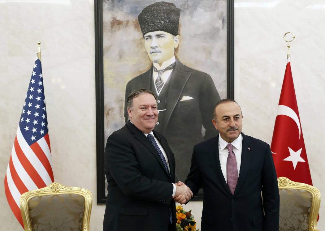U.S. Secretary of State Mike Pompeo shakes hands with Turkish Foreign Minister Mevlut Cavusoglu before their talks in Ankara, Turkey, October 17, 2018. On Wednesday a pro-government Turkish news ...