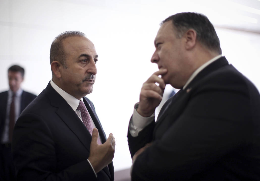 Turkey's Foreign Minister Mevlut Cavusoglu, left, talks with U.S. Secretary of State Mike Pompeo at the Esenboga Airport in Ankara, Turkey, Wednesday, Oct. 17, 2018. Pro-government newspaper Yeni ...