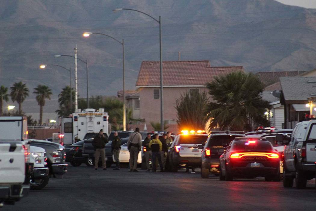 Police and SWAT have surrounded a far east valley neighborhood Wednesday, Oct. 17, 2018, while they search for a suspect in a Tuesday shooting that led police on a high-speed chase around the city ...