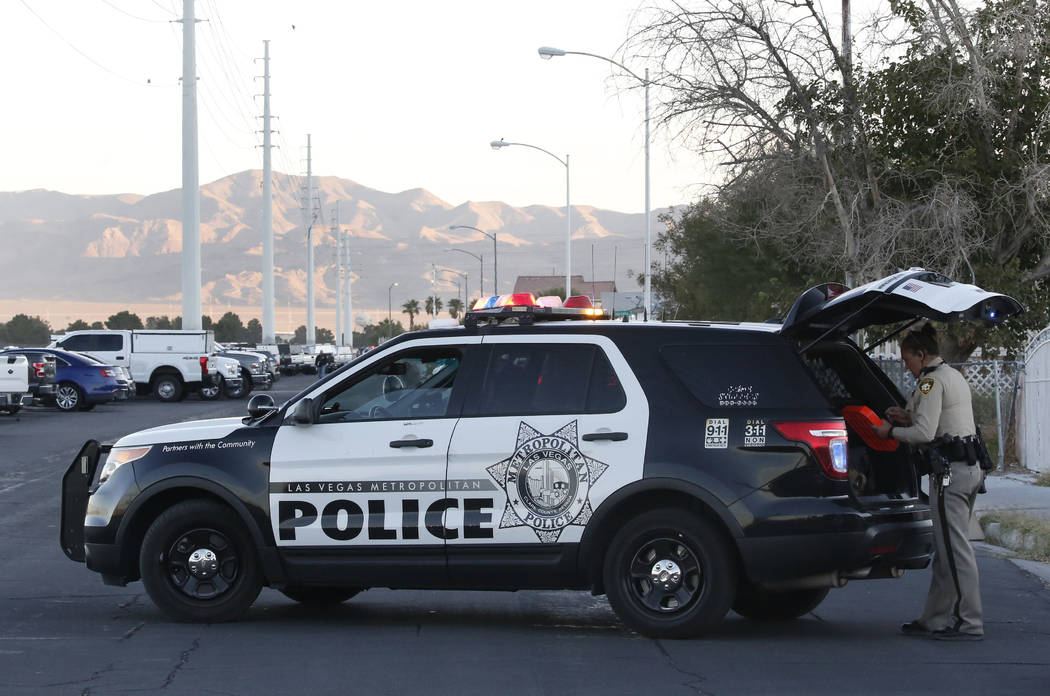 Toiyabe Street is blocked off as police and SWAT have surrounded a far east valley neighborhood on Wednesday, Oct. 17, 2018, while they search for a suspect in a Tuesday shooting that led police o ...