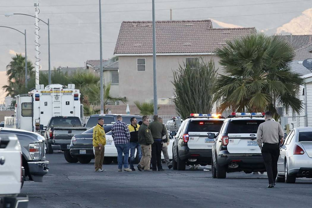 Police and SWAT surrounded an east valley neighborhood on Wednesday, Oct. 17, 2018, while they searched for a suspect who led police on a high-speed chase overnight. Three people were taken into c ...