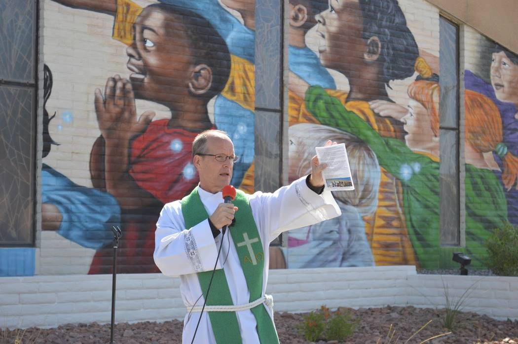 Pastor Brad Beckman leads the crowd in prayer outside the First Good Shepherd Lutheran Church in downtown Las Vegas during a mural dedication on Sunday, Oct. 14, 2018. (Ava Kessler/First Good Shep ...
