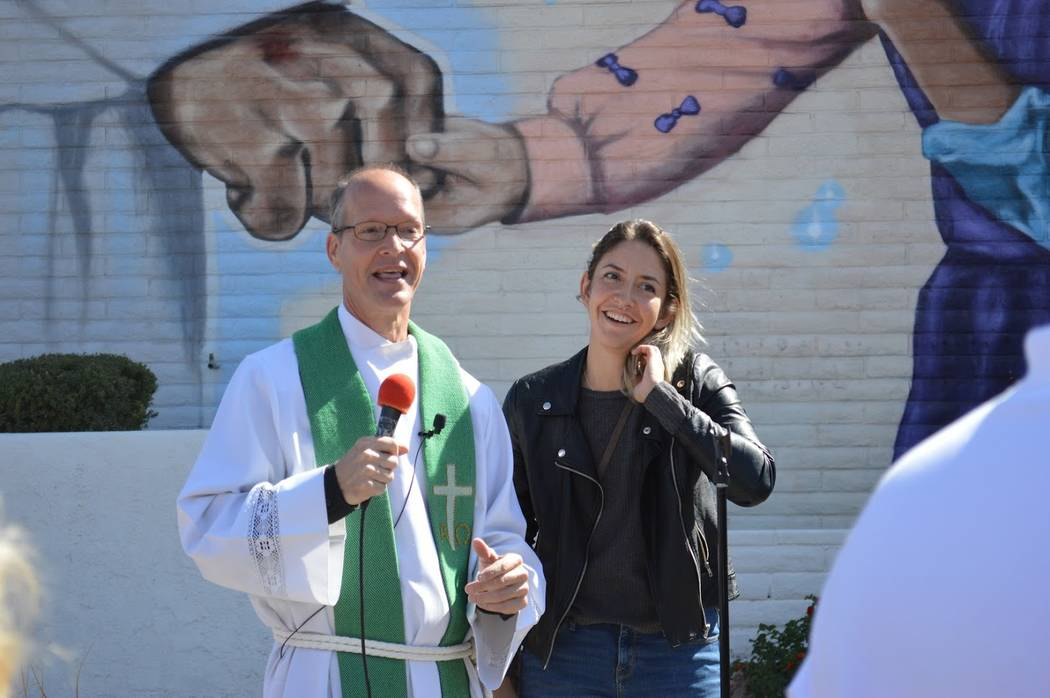 Pastor Brad Beckman thanks muralist Heather Toledo outside First Good Shepherd Lutheran Church in downtown Las Vegas during a mural dedication on Sunday, Oct. 14, 2018. Toledo spent five months pa ...