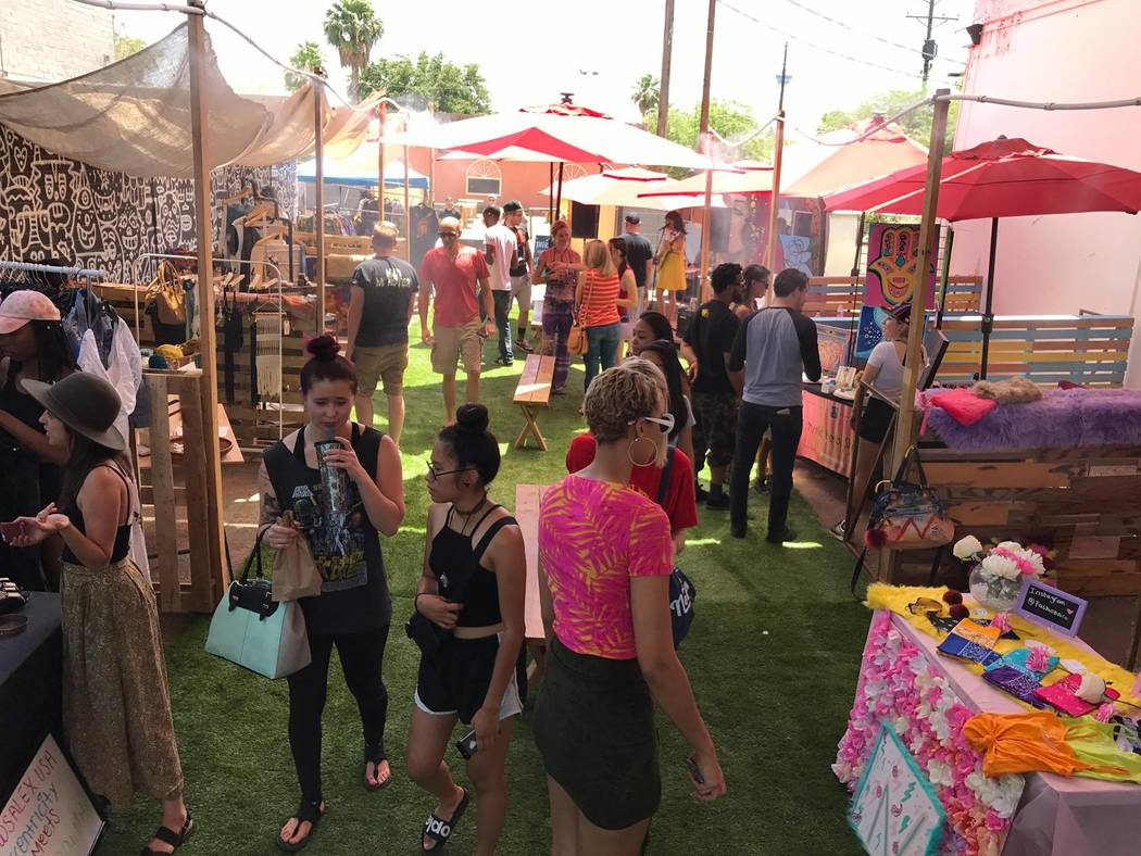 Shoppers wander the Market in the Alley in June. The Downtown Project- and Tony Hsieh-affiliated group behind the market wants to eventually take the pop-up to once a week. Megan Fazio