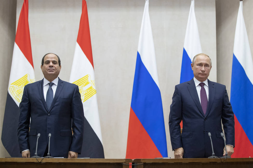 Russian President Vladimir Putin, right, and Egyptian President Abdel-Fattah el-Sisi pause during a minute of silence to commemorate the victims of an explosion in a vocational college in Crimea, ...