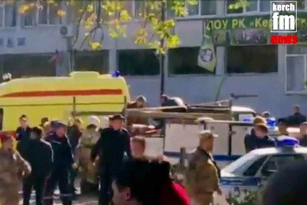 The scene as emergency services load an injured person onto a truck, in Kerch, Crimea, Wednesday Oct. 17, 2018. An explosive device has killed several people and injured at least 50 others at a v ...