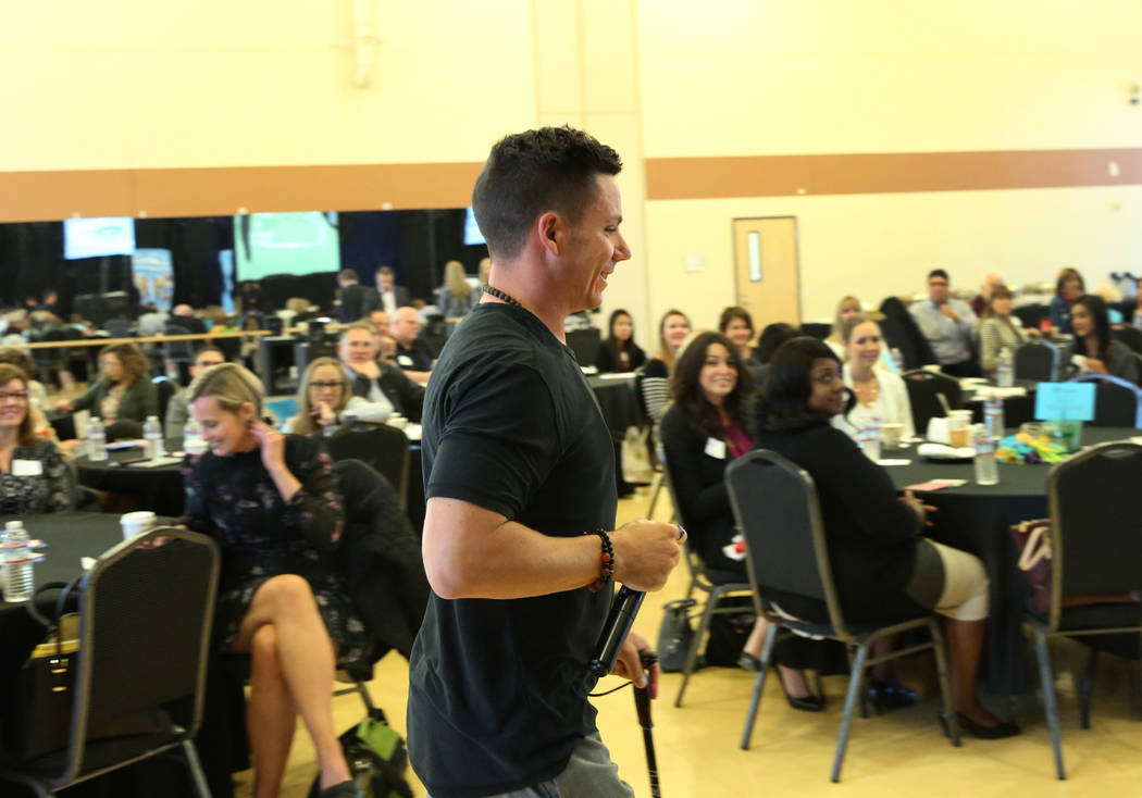 High Fives Foundation Founder and a retired pro skier, Roy Tuscany, takes the podium to speak at the Nevada Health Link forum on Wednesday, Oct. 17, 2018, in Las Vegas. The forum is for health ins ...
