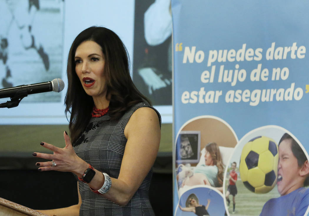 Desiree Don Reed-Francois, athletic director at the University of Nevada, Las Vegas, speaks at the Nevada Health Link forum on Wednesday, Oct. 17, 2018, in Las Vegas. The forum is for health insur ...