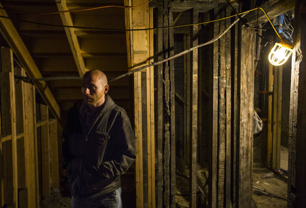 Ramsey Cline walks around the basement level as renovations go on at the Belvada in Tonopah on Friday, Oct. 12, 2018. The Belvada originally opened as the State Bank and Trust Company Building in ...