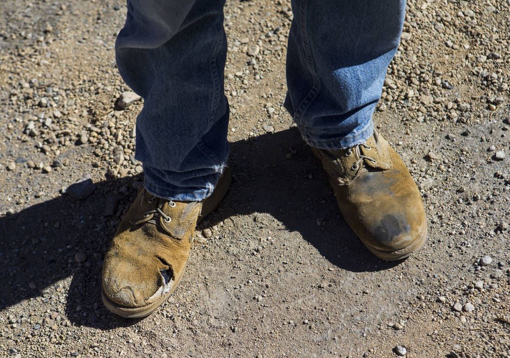 The boots of Ramsey Cline outside of the Belvada in Tonopah on Friday, Oct. 12, 2018. The Belvada originally opened as the State Bank and Trust Company Building in 1906. Chase Stevens Las Vegas Re ...
