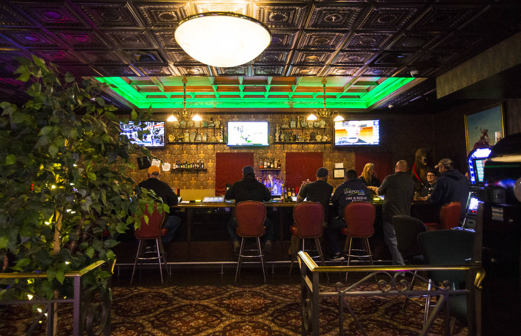 People drink at the bar at the Mizpah Club in Tonopah on Thursday, Oct. 11, 2018. Chase Stevens Las Vegas Review-Journal @csstevensphoto