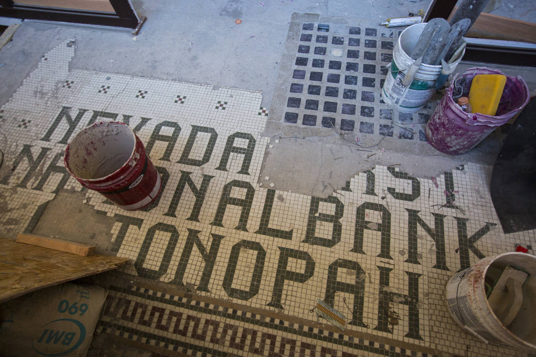 Paint and old tile are shown as renovations go on at the Belvada in Tonopah on Friday, Oct. 12, 2018. The Belvada originally opened as the State Bank and Trust Company Building in 1906. Chase Stev ...