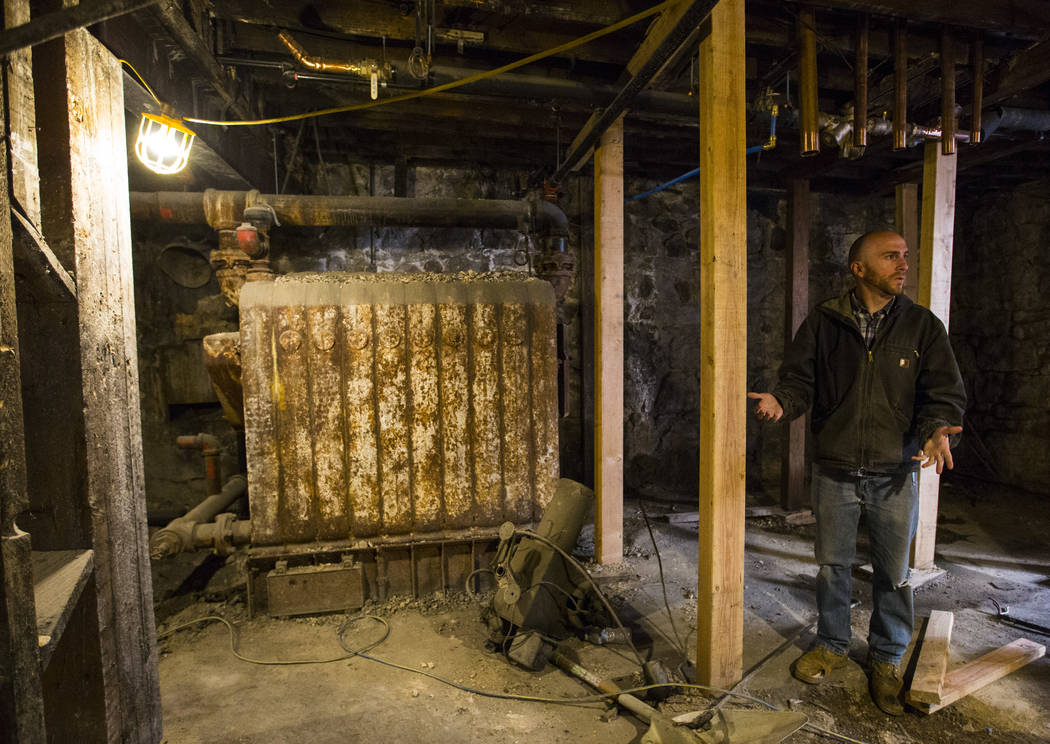 Ramsey Cline talks about the old boiler in the basement level as renovations go on at the Belvada in Tonopah on Friday, Oct. 12, 2018. The Belvada originally opened as the State Bank and Trust Com ...