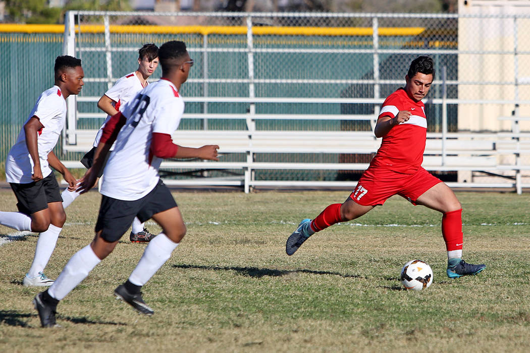 Juan Estrada, 17, a forward for the Western Warriors, plays against Somerset-Losee Academy at Western High School in Las Vegas, Wednesday, Oct. 17, 2018. Estrada has scored the most goals for a pl ...