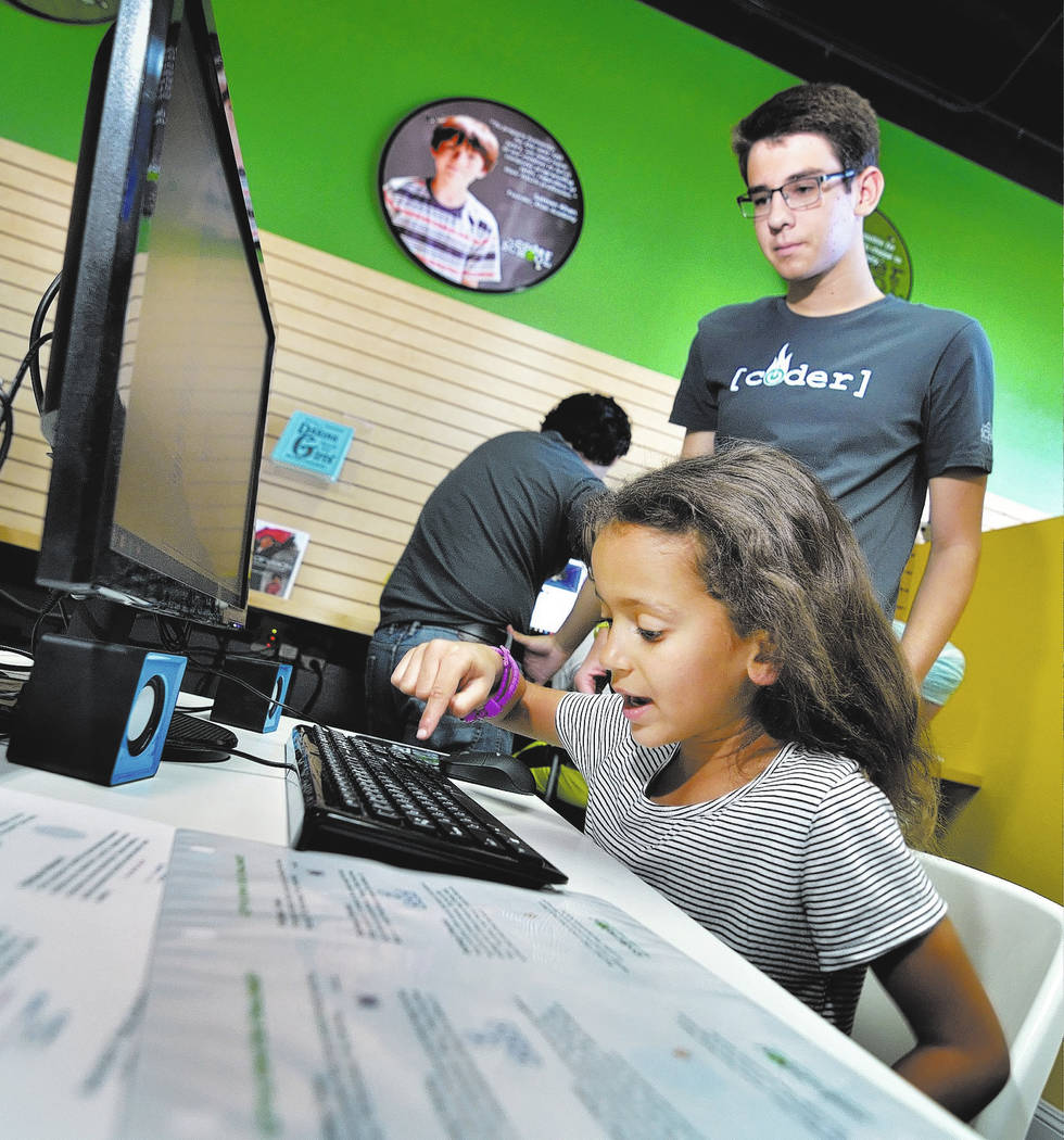 Code coach Alexander Schupp, standing, works with Camila Rogier, 5, of Las Vegas during the grand opening of theCoderSchool at 9330 W. Sahara Ave. in Las Vegas on Saturday, Oct. 20, 2018. Bill Hug ...