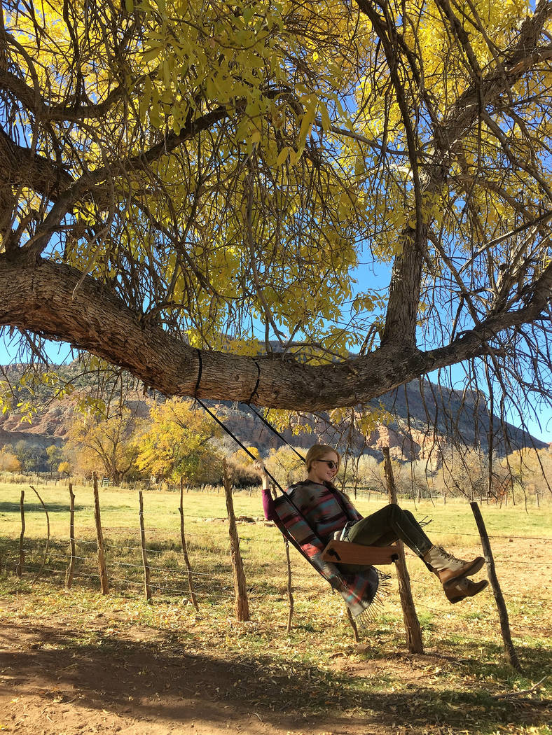 A visitor enjoying the tree swing in the yard of the 1879 Louisa Marie Russell Home in Grafton, Utah. (Deborah Wall/Las Vegas Review-Journal)