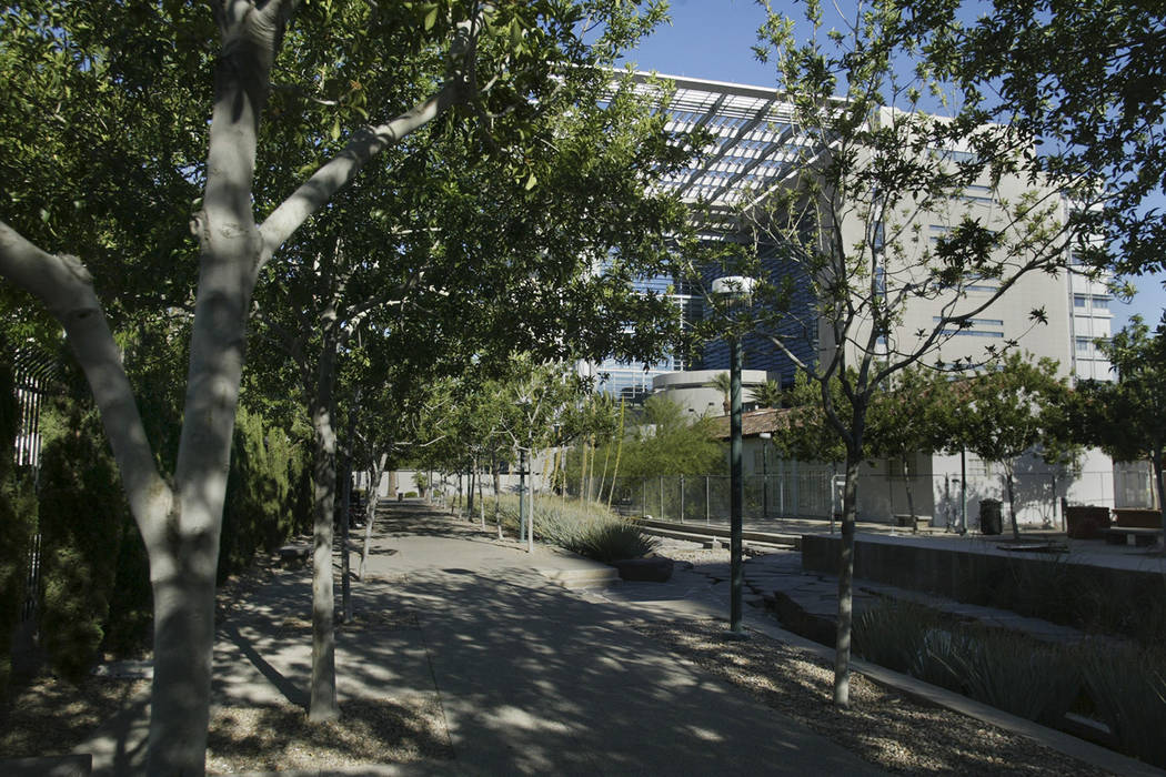 The Lloyd George U.S. Courthouse is shown through trees along a walkway in Centennial Plaza on Sunday, June 22, 2008, in downtown Las Vegas. (Las Vegas Review-Journal File)