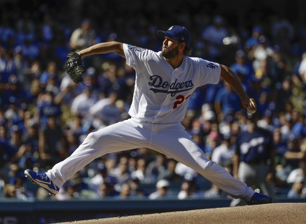 Los Angeles Dodgers starting pitcher Clayton Kershaw throws during the first inning of Game 5 of the National League Championship Series baseball game against the Milwaukee Brewers Wednesday, Oct. ...