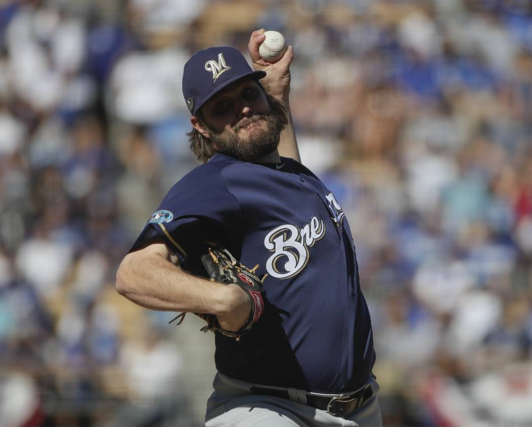 Milwaukee Brewers' Wade Miley throws during the first inning of Game 5 of the National League Championship Series baseball game against the Los Angeles Dodgers Wednesday, Oct. 17, 2018, in Los Ang ...