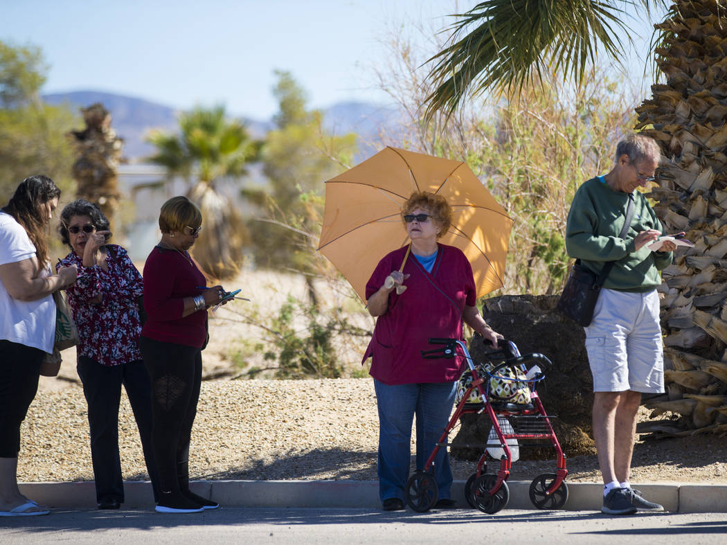 Paula Henry, center, of North Las Vegas lines up outside of the Primm Valley Lotto Store as people wait to buy the Mega Millions lottery tickets in Primm on Thursday, Oct. 18, 2018. It was Henrys ...