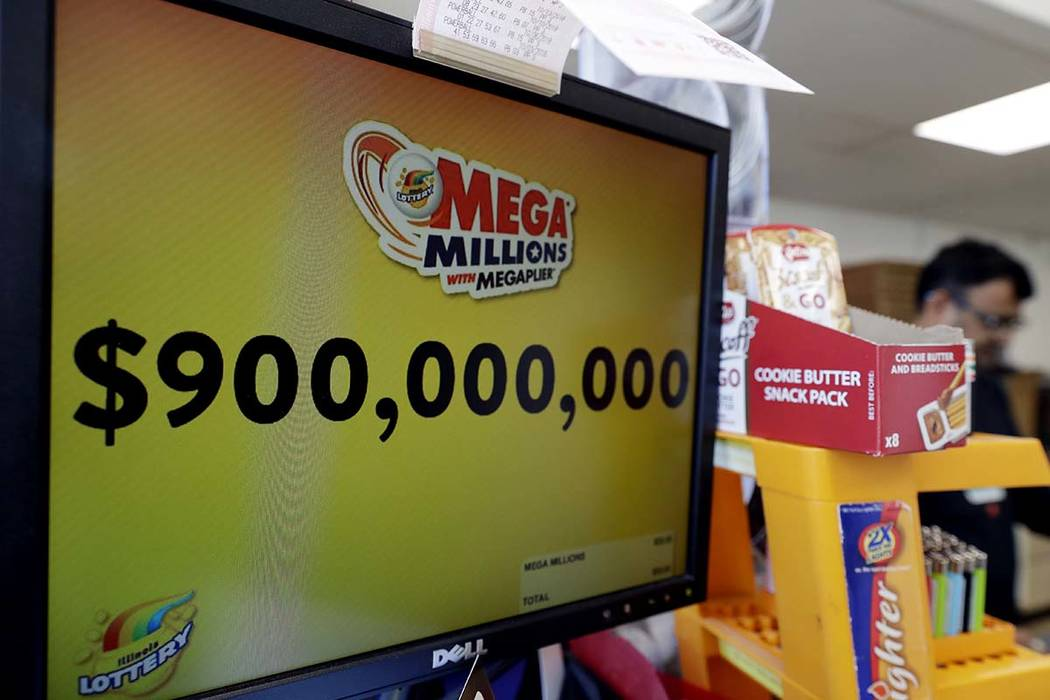 The Mega Millions jackpot is displayed at a convenience store Wednesday, Oct. 17, 2018, in Chicago. The Mega Millions jackpot is now up to $900 million. (Nam Y. Huh/AP)