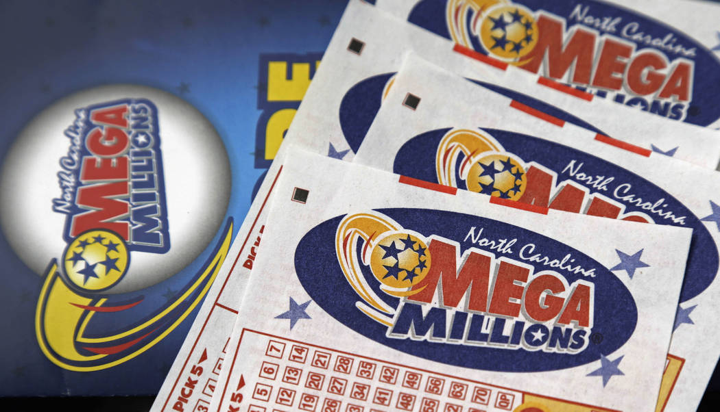 FILE - This July 1, 2016, file photo shows Mega Millions lottery tickets on a counter at a Pilot travel center near Burlington, N.C. After nearly three months without a winner, the Mega Millions l ...