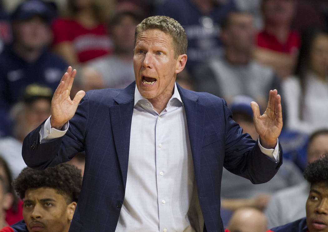 Gonzaga coach Mark Few questions a foul call during the second half of the team's NCAA college basketball game against Loyola Marymount in the quarterfinals of the West Coast Conference men's tour ...