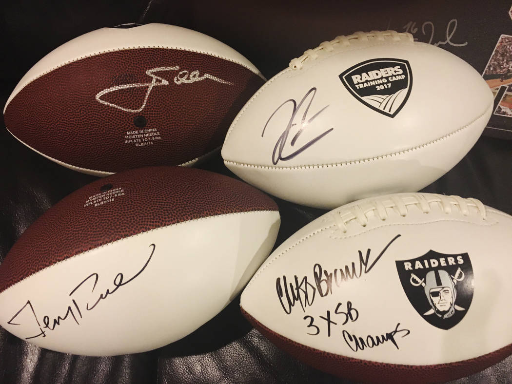 Raiders coach Jon Gruden (top left), Hall of Fame wide receiver Jerry Rice (bottom left), quarterback Derek Carr (top right) and Hall of Fame wide receiver Cliff Branch each signed a football for ...