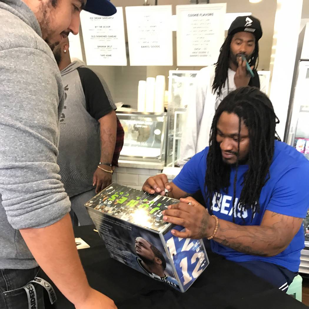 Raiders fan Jose Valenzuela received an autograph from Oakland native Marshawn Lynch, a then-retired and now-Raiders running back, during a meet-and-greet at Cookiebar Creamery on Nov. 11, 2016. ( ...