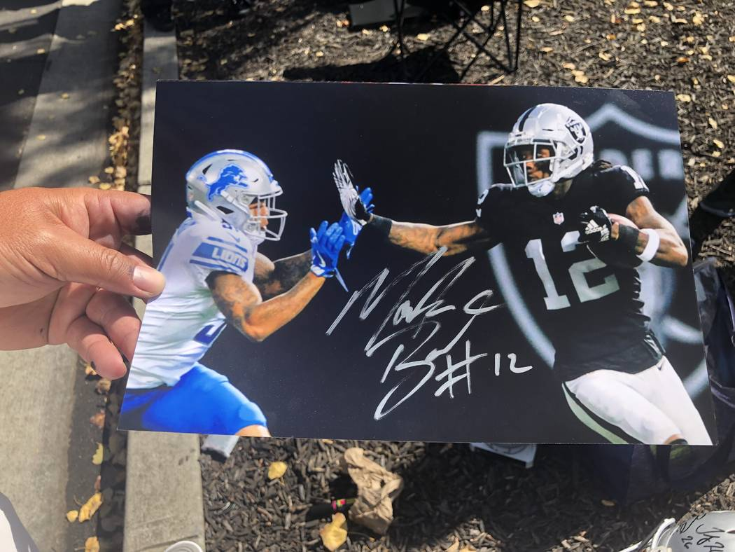 Raiders fan Jose Valenzuela holds a photo that wide receiver Martavis Bryant autographed in 2018 just outside of team headquarters. (Michael Gehlken/Las Vegas Review-Journal)