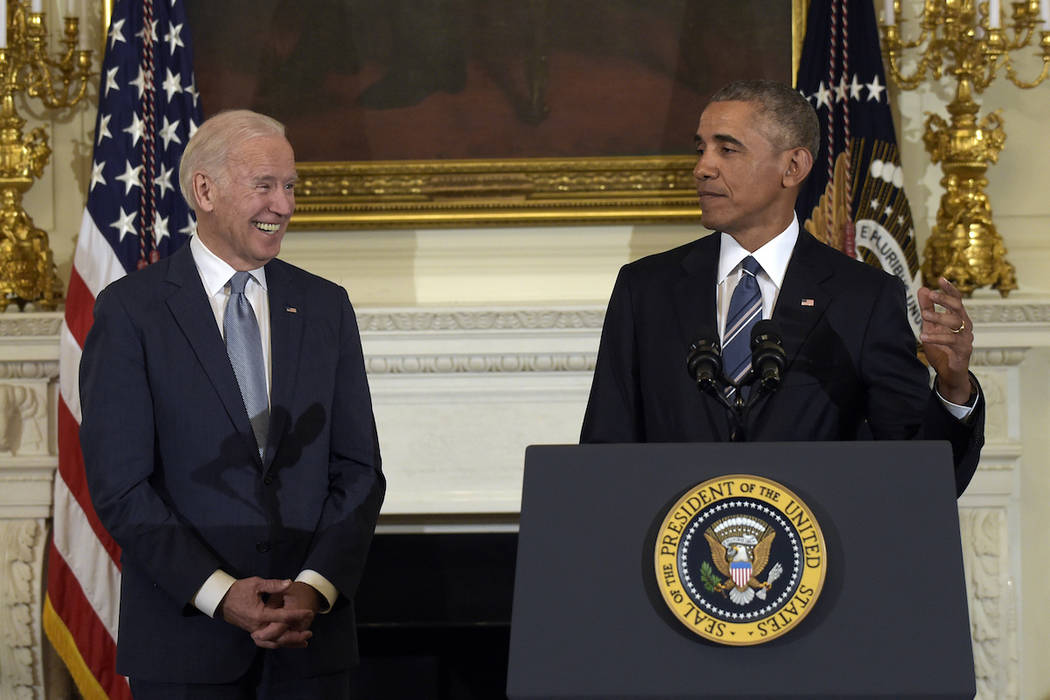 President Barack Obama, right, honors Vice President Joe Biden, left, during a ceremony in the State Dining Room of the White House in Washington, Thursday, Jan. 12, 2017. Obama surprised Biden an ...