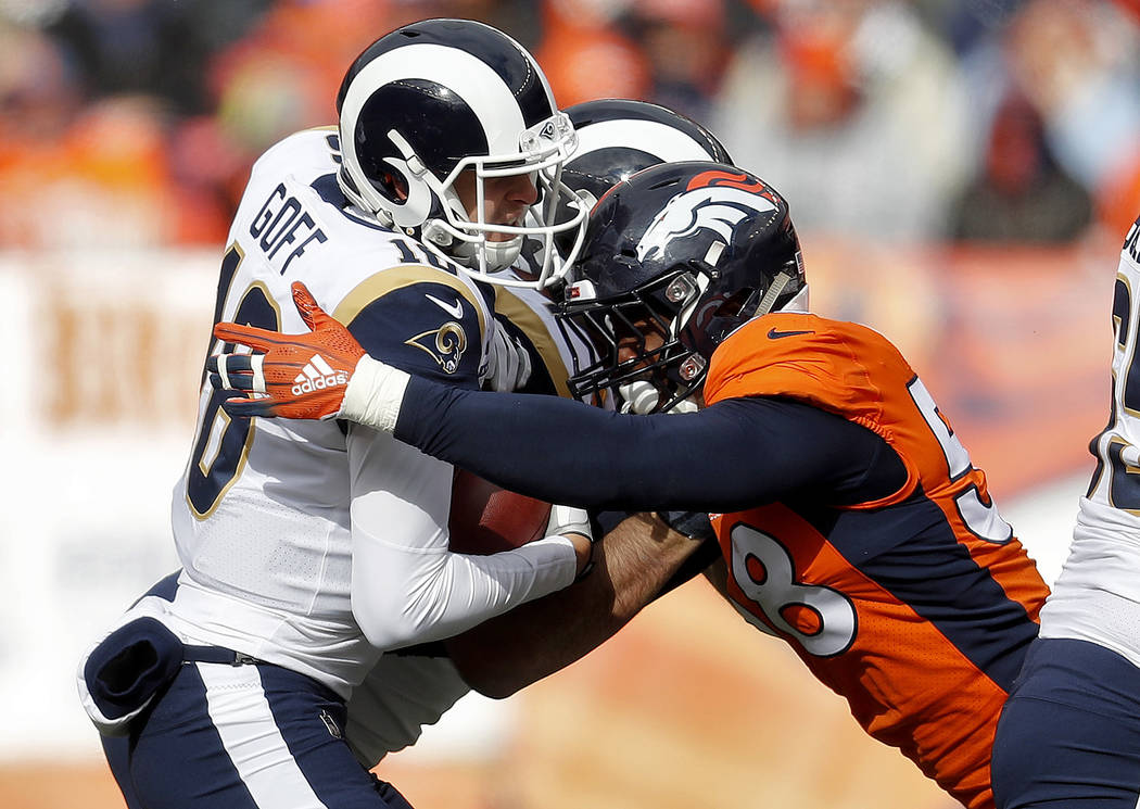 Denver Broncos linebacker Von Miller (58) sacks Los Angeles Rams quarterback Jared Goff (16) during the first half of an NFL football game, Sunday, Oct. 14, 2018, in Denver. (AP Photo/David Zalubo ...