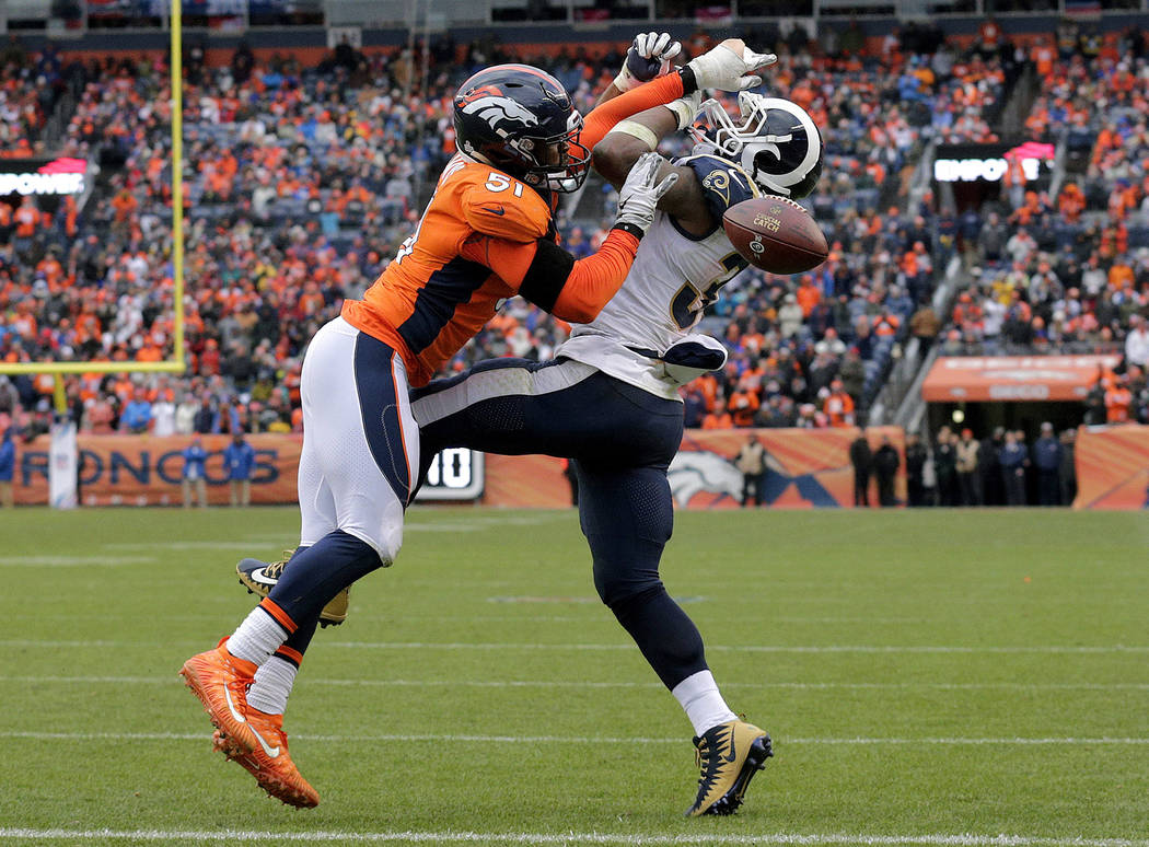 Denver Broncos linebacker Todd Davis (51) breaks up a pass intended for Los Angeles Rams running back Todd Gurley during the second half of an NFL football game, Sunday, Oct. 14, 2018, in Denver. ...
