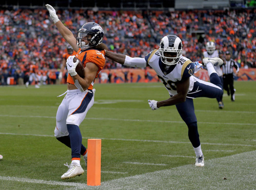 Denver Broncos running back Phillip Lindsay (30) is stopped short of the goal line by Los Angeles Rams free safety Lamarcus Joyner (20) during the second half of an NFL football game, Sunday, Oct. ...