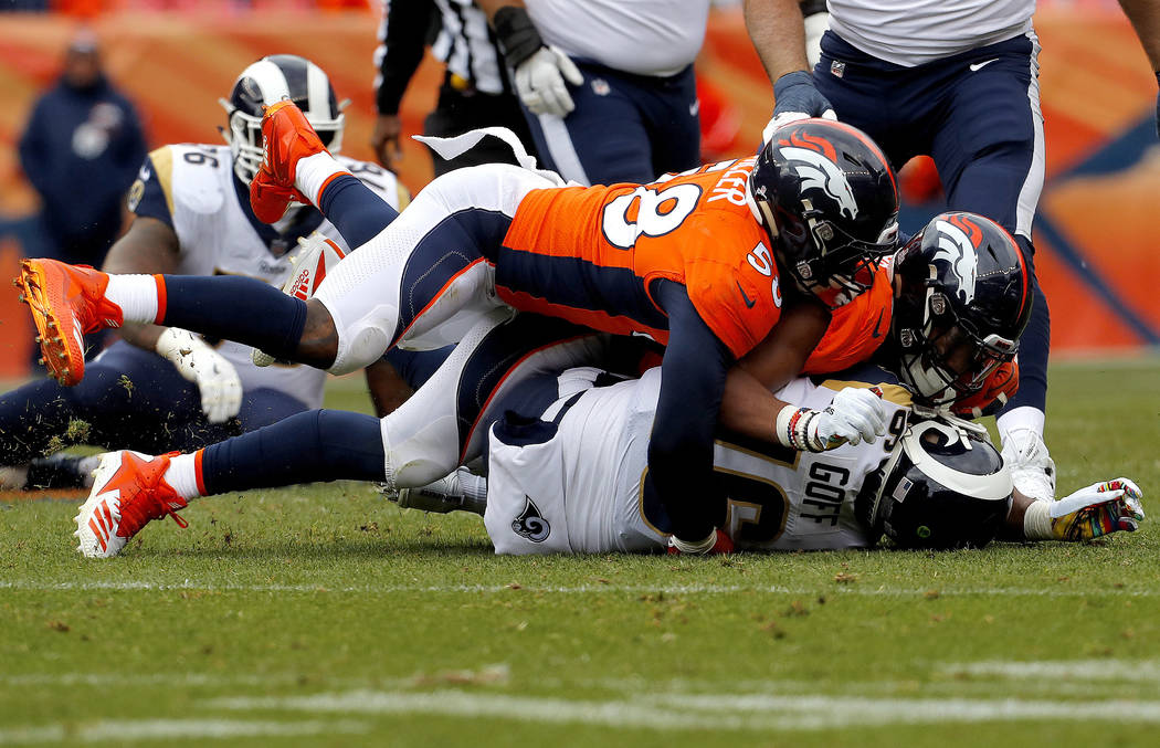 Denver Broncos linebacker Von Miller (58) and Denver Broncos linebacker Bradley Chubb sack Los Angeles Rams quarterback Jared Goff (16) during the first half of an NFL football game, Sunday, Oct. ...