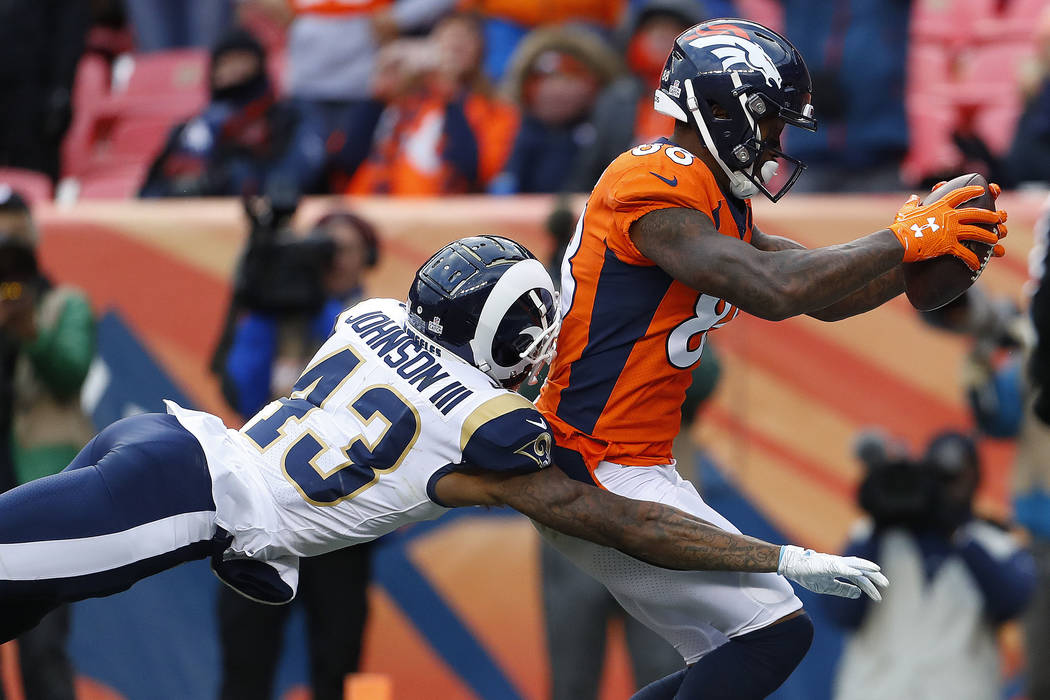 Denver Broncos wide receiver Demaryius Thomas (88) scores a touchdown as Los Angeles Rams strong safety John Johnson (43) defends during the second half of an NFL football game, Sunday, Oct. 14, 2 ...