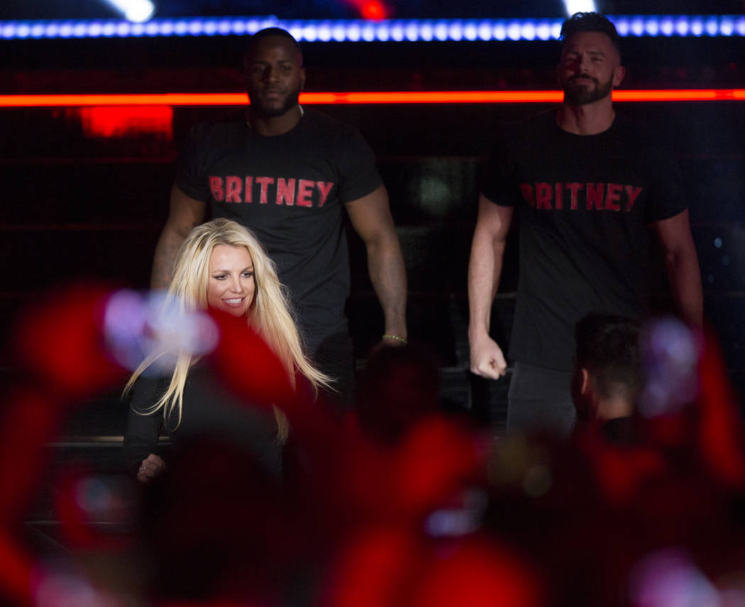 Britney Spears signs autographs during an event to announce her new residency at The Park Theater at Park MGM on Thursday, Oct. 18, 2018, outside T-Mobile Arena, in Las Vegas. Provided Las Vegas R ...