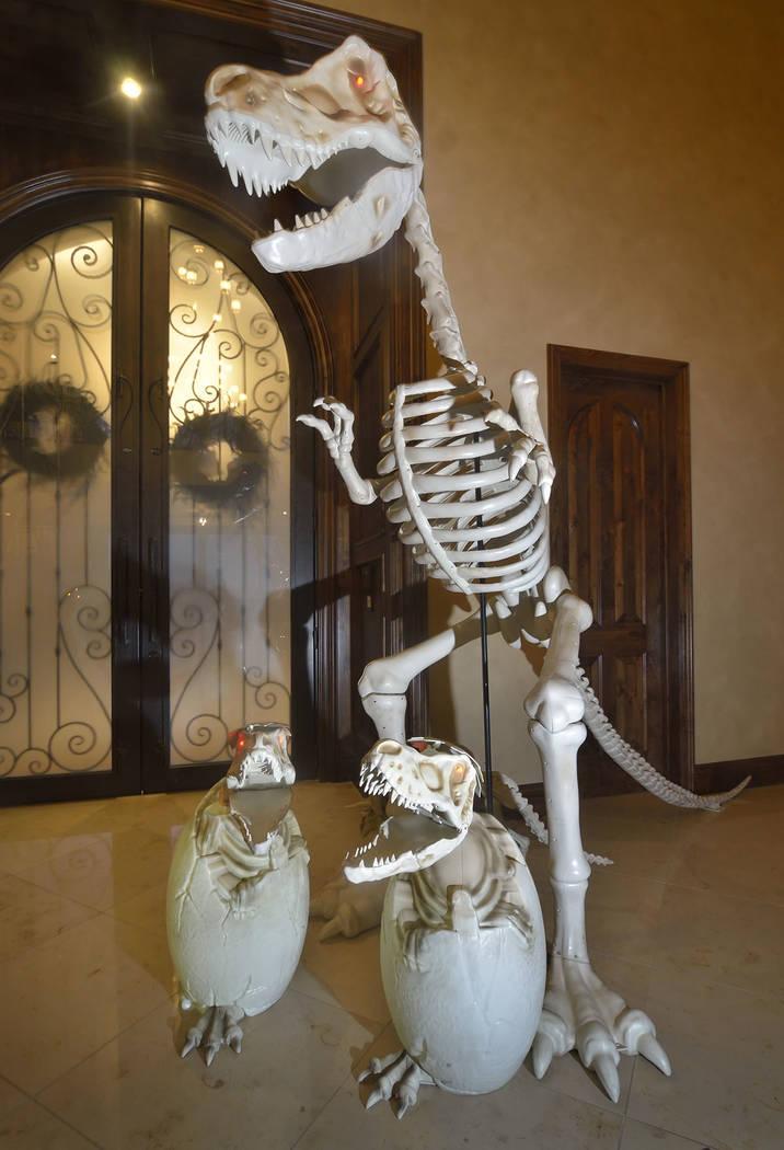 A dinosaur skeleton greets visitors at the door. (Bill Hughes Real Estate Millions)