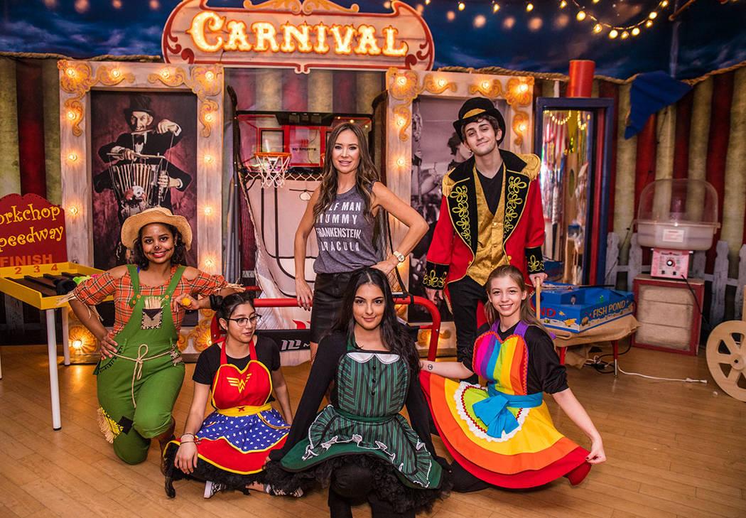 Luxury Realtor Nicole Tomlinson, center is joined by her Operation Halloween crew, from left, Gabriella De Leon, Irene Chavira, Noemi Casillas, Morgan Rooney and William Cutler. (Tonya Harvey Real ...