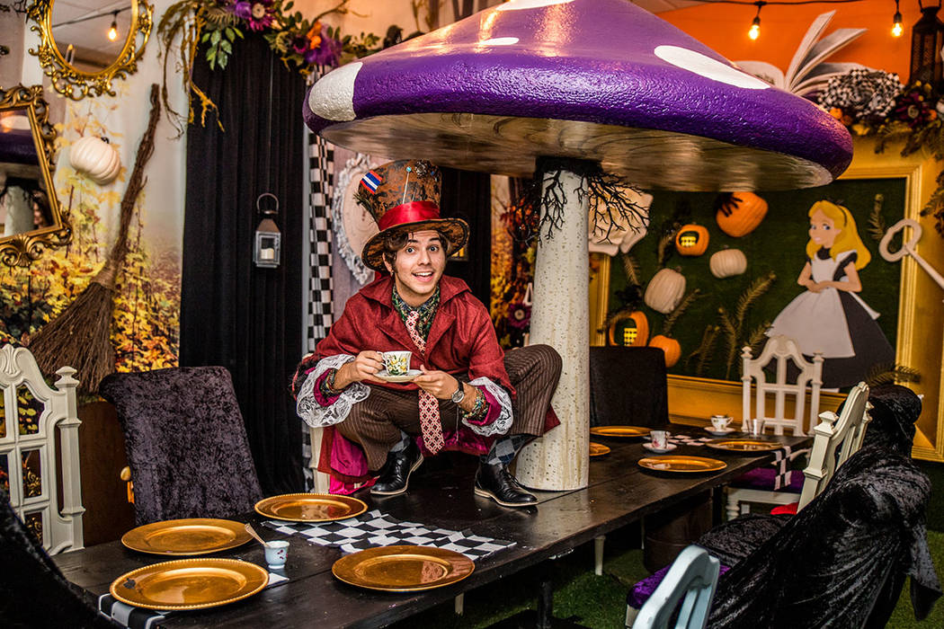 David Tovar is the Mad Hatter in the Alice in Wonderland room at Operation Halloween. (Tonya Harvey Real Estate Millions)