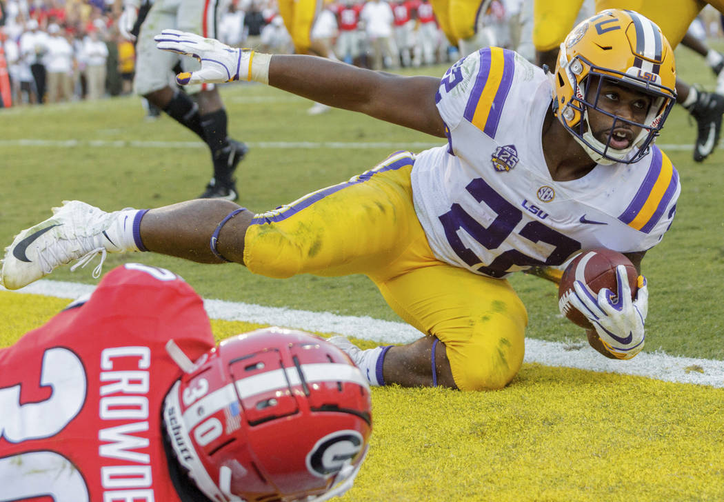 LSU running back Clyde Edwards-Helaire (22) is stopped just short of a touchdown by Georgia linebacker Tae Crowder (30) during the second half of an NCAA college football game in Baton Rouge, La., ...