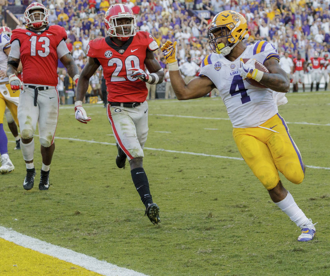 LSU running back Nick Brossette (4) scores a touchdown against Georgia during the second half of an NCAA college football game in Baton Rouge, La., Saturday, Oct. 13, 2018. (AP Photo/Matthew Hinton)