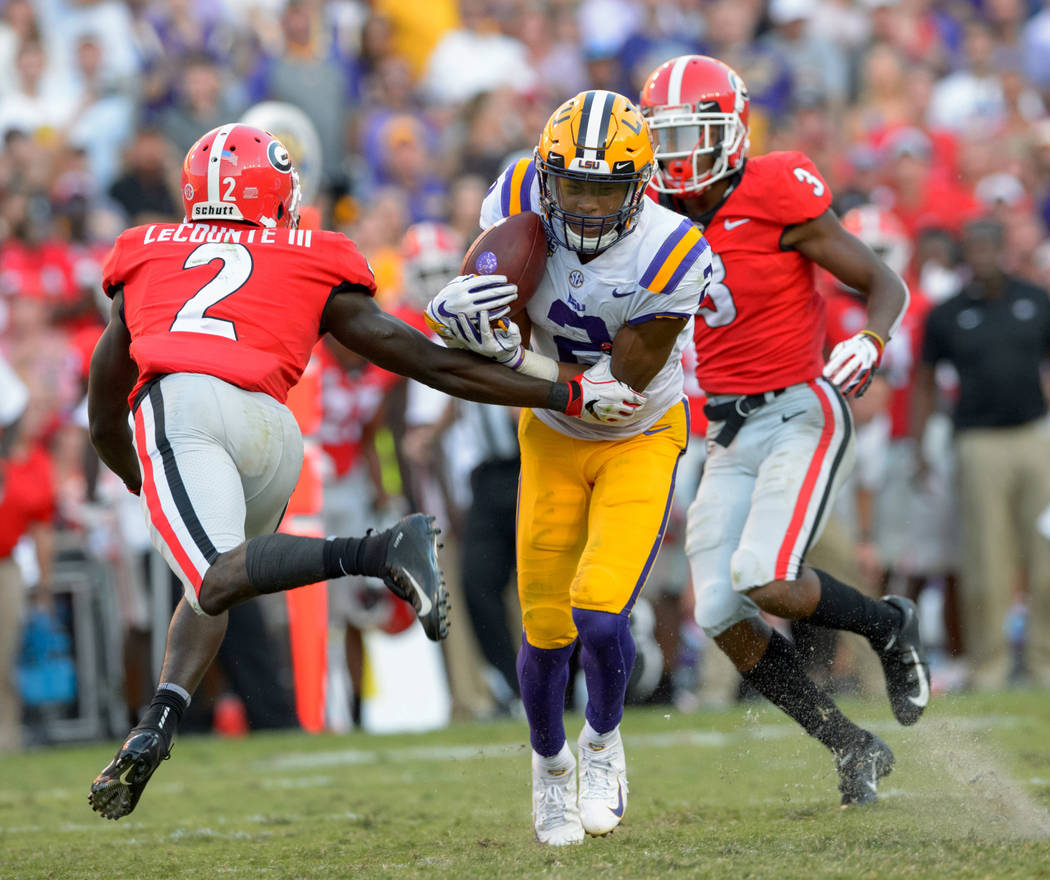 LSU wide receiver Justin Jefferson (2) makes a reception against Georgia defensive back Richard LeCounte (2) during the second half of an NCAA college football game in Baton Rouge, La., Saturday, ...