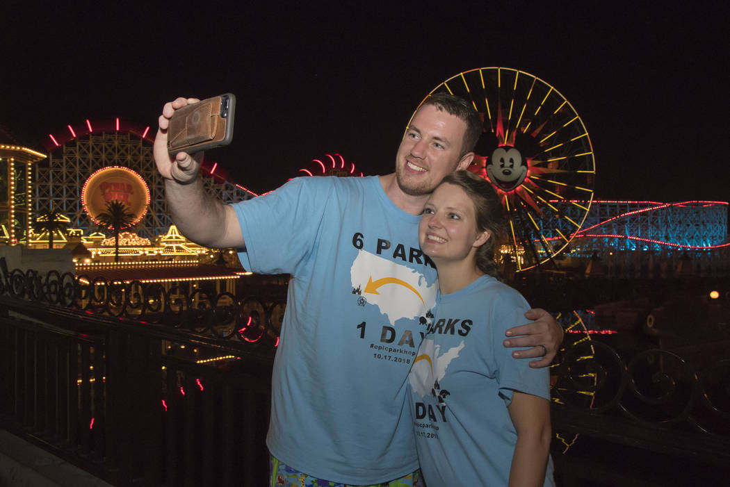 (l-r) Clark and Heather Ensminger of Kingsport, Tennessee, take a selfie before riding Incredicoaster at Pixar Pier at Disney California Adventure Park in Anaheim, Calif., Oct. 17, 2018.(Joshua Su ...