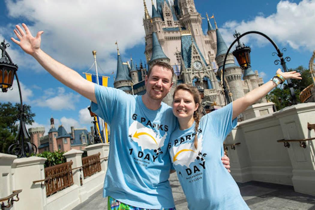 Clark and Heather Ensminger of Kingsport, Tenn., pose in front of the iconic Cinderella Castle in Magic Kingdom Park at Walt Disney World Resort in Lake Buena Vista, Fla. (Courtesy Disney Parks)